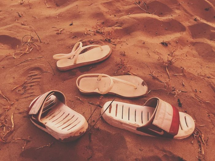 Sand Beach Shoe Flip-flop No People Outdoors His & Hers Nike Havaianas High Angle View