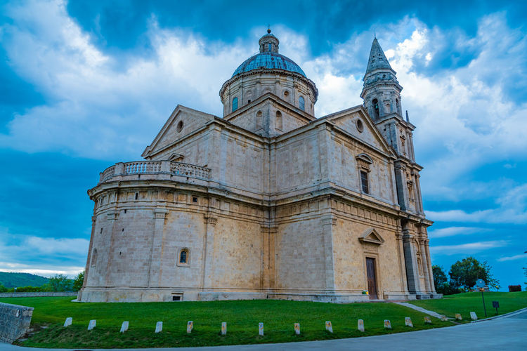 Low Angle View Of San Biagio Against Cloudy Sky