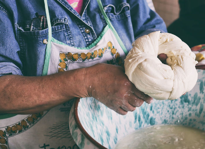 Midsection of woman preparing dough