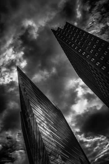 Mystical Mystic Ominous Ominous Beauty Futuristic Eerie Berlin Vertical Shot Black And White Photography B & W Photography Black & White Photography Dramatic Sky Cloud - Sky Low Angle View Architecture Sky Built Structure Building Exterior Tall - High Building No People Office Building Exterior City Tower Skyscraper Modern Dusk