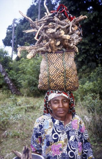 Village Life. Zanzibari Woman carrying Firewood on her head. Zanzibar, Tanzania Culture Customs Day East Africa Ethnic Ethnicity Firewood One Person Outdoors People Portrait Real People Smiling Traditions Travel Photography Village Life In Zanzibar Zanzibar_Tanzania Zanzibari Zanzibarisland