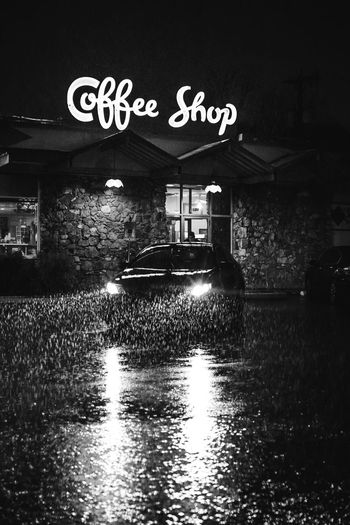 Noir Text Communication Architecture Western Script Built Structure Building Exterior Water Street Transportation Wet Reflection Rain Outdoors Illuminated City Sign