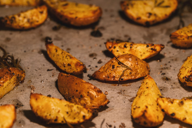 Baked potato wedges with spices, herbs and oil on baking tray - homemade organic vegetable vegan vegetarian snack food meal Dinner Golden Homemade Hot Meal Potato Rosemary Salt Snack Vegetarian Food Baking Tray Delicious Fried Kitchen Oil Olive Oil Paper Pepper Roasted Rusitc Spice Tasty Thyme Vegan Wedge