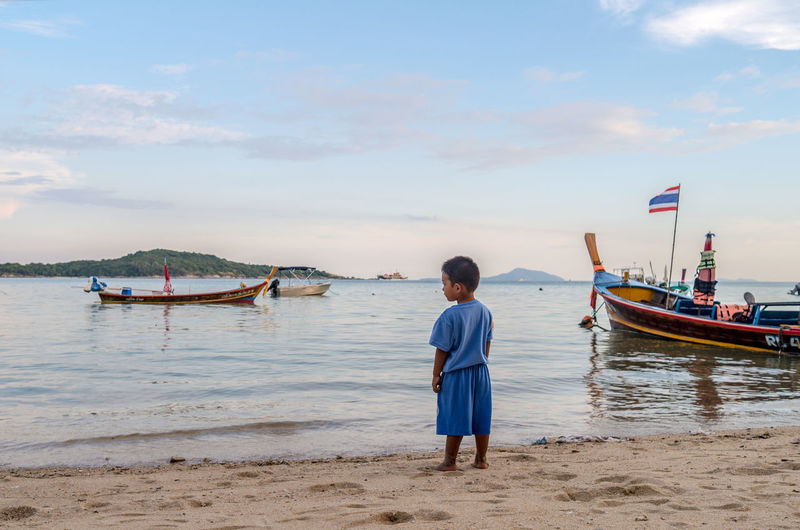 Thai boy gazing into the future Leicacamera Thailand Water Beauty In Nature Beach Sea People Water Blue Sky Sand One Person Outdoors Day Travel Destinations Nautical Vessel Boys Child Horizon Over Water