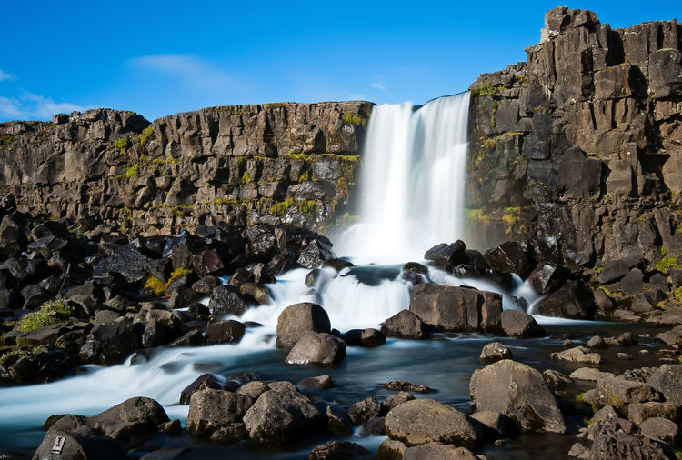 Oxararfoss waterfall in Thingvellir National Park, Iceland. Oxararfoss Thingvellir National Park Iceland Water Rock Solid Rock - Object Waterfall Scenics - Nature Long Exposure Beauty In Nature Motion Flowing Water Nature Rock Formation Day No People Sea Sky Flowing Outdoors Power In Nature Falling Water Landscape