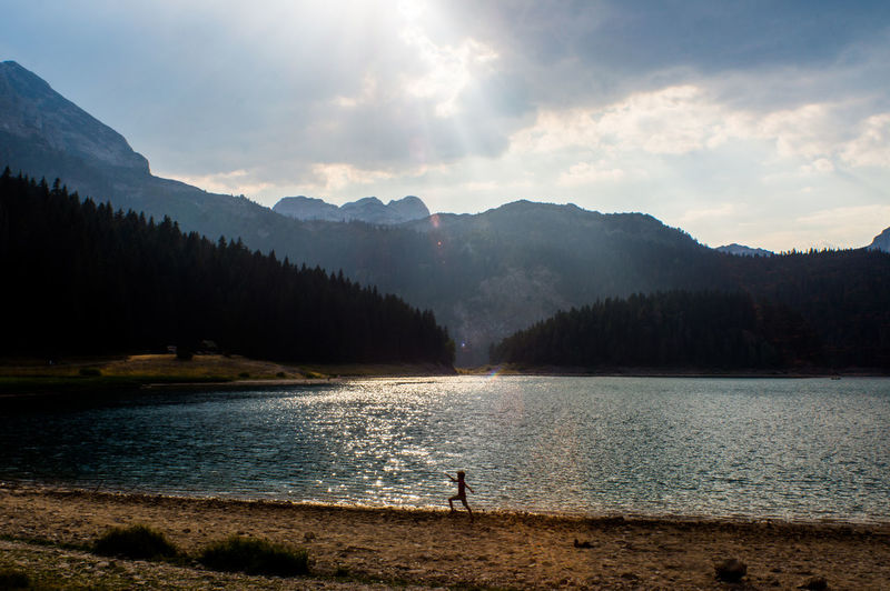Silhouette Blue Dramatic Forest Lake Landscape Mountain Sun Flares Sunny Day Water A New Beginning Capture Tomorrow Moments Of Happiness