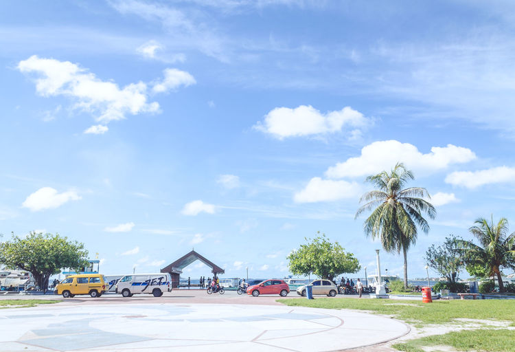 Beach Cars Blue Cloud Cloud - Sky Cloudy Day Growth Holiday Holiday POV Land Vehicle Mode Of Transport Nature No People Outdoors Palm Tree Parking Lot Road Sky Travel Destinations Tree Vacation Sommergefühle EyeEm Selects An Eye For Travel Visual Creativity