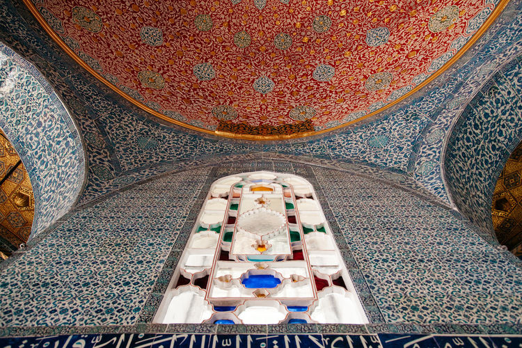 Low angle view of mosaic ceiling
