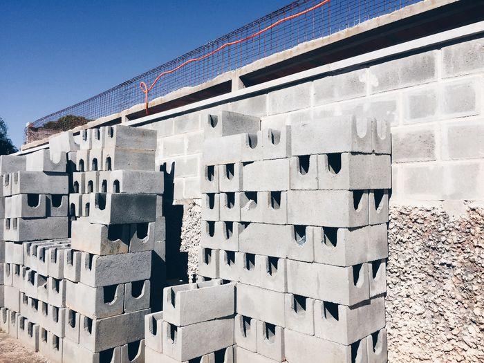 Stack Of Bricks By Wall