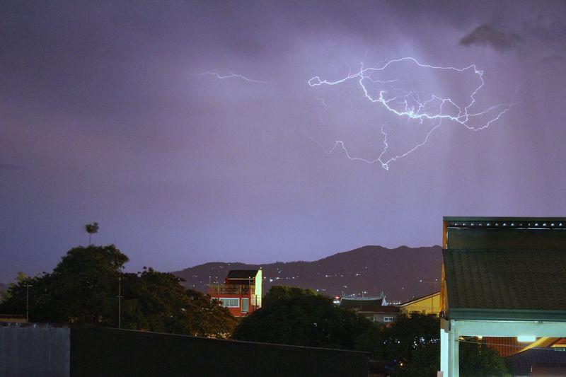 Lightning over city at night