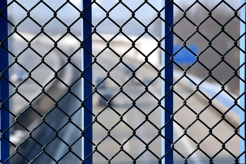 Chainlink Fence Fence Protection Pattern Metal Full Frame Safety No People Outdoors Backgrounds Day Sky Crisscross Close-up Highway Nature Pollution Environmental Damage Environmental Disaster Protesters Stop Pollution Coldcolours Architecture Symmetry Silhouette Flying High EyeEmNewHere Resist