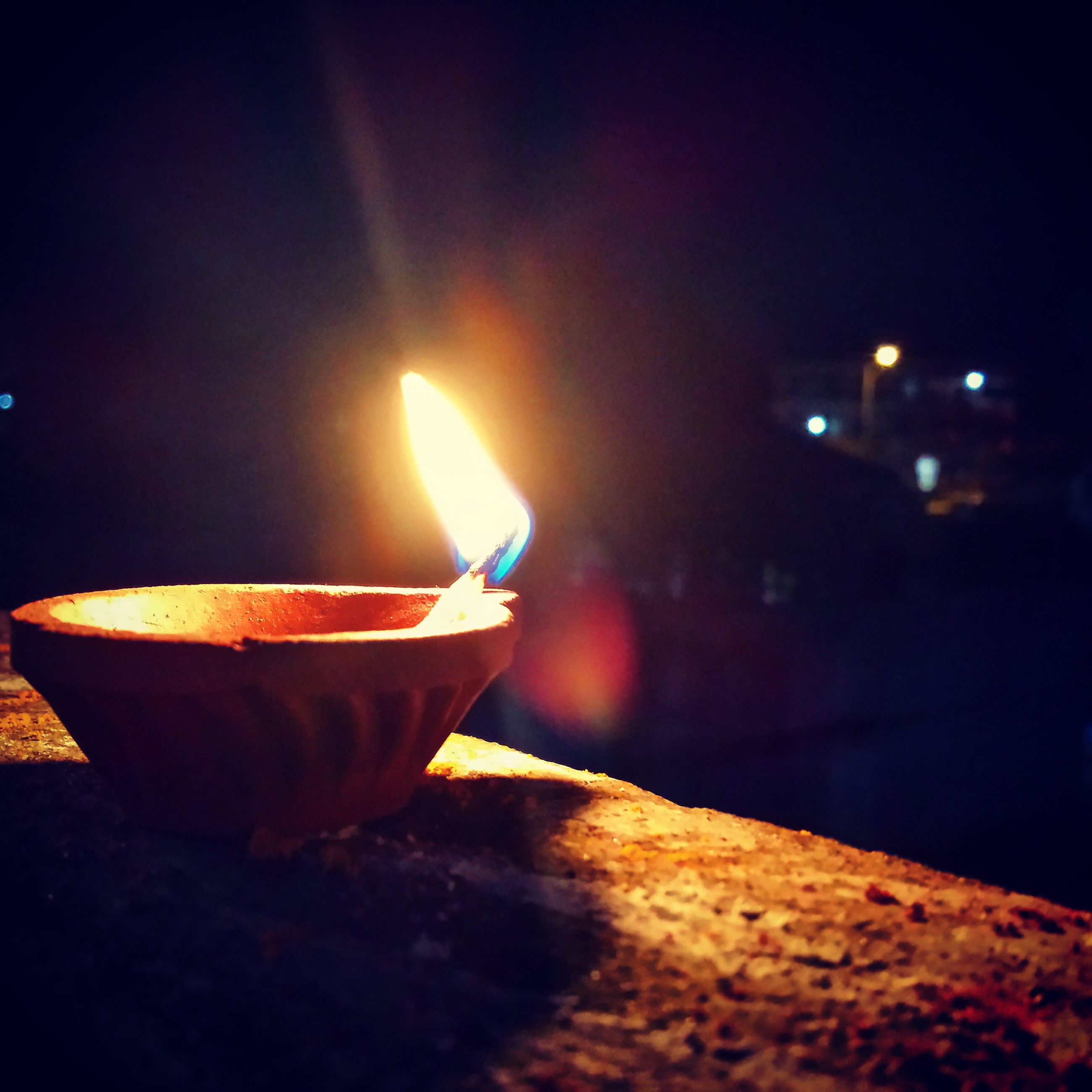 night, burning, illuminated, flame, heat - temperature, glowing, lighting equipment, diya - oil lamp, diwali, oil lamp, celebration, close-up, no people, retaining wall, outdoors