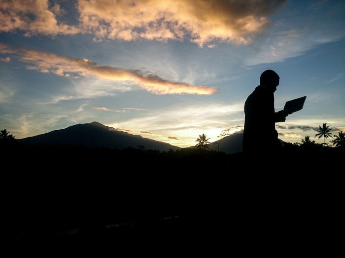 Silhouette of man against sky during sunset