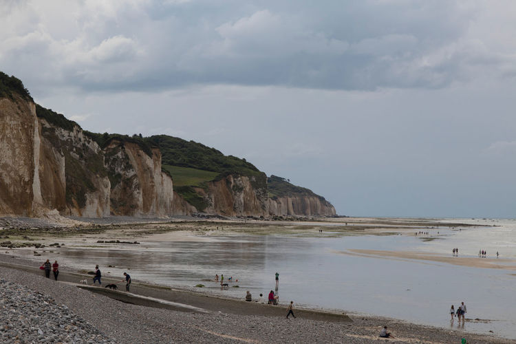 A tranquil day at a Normandy beach, unlike what it would have been in WWII Beach Water Sand Cliff Normandy Beaches Normandy, France People On Beach Tide