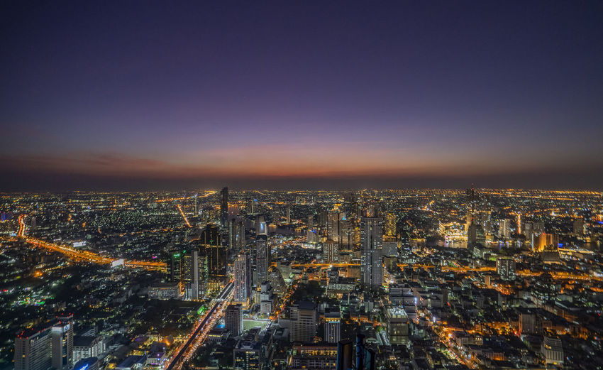 City Building Exterior Architecture Cityscape Built Structure Illuminated Sky Building High Angle View Aerial View Night City Life Crowded Urban Skyline Nature Crowd Travel Destinations Skyscraper Office Building Exterior Outdoors Bangkok Thailand. Twilight Urban City Life Rooftop