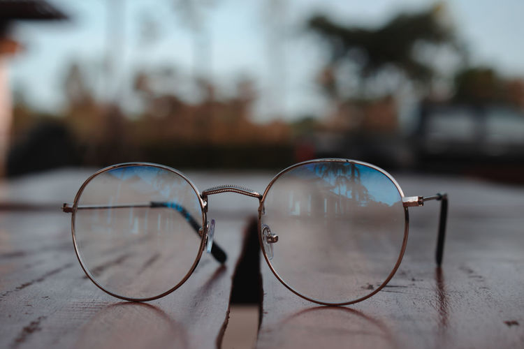 Close-up of sunglasses against blurred background