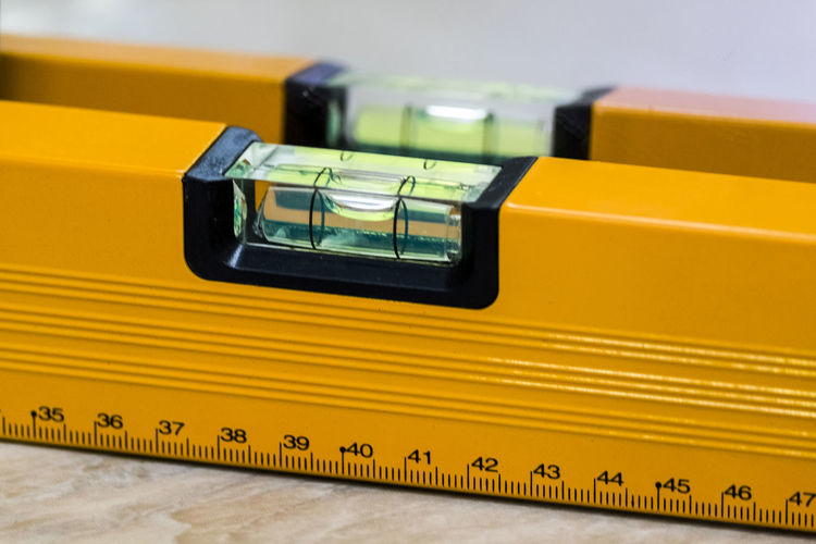 measuring device with a level Close-up Equipment Focus On Foreground High Angle View Indoors  Metal Multi Colored No People Orange Color Single Object Yellow