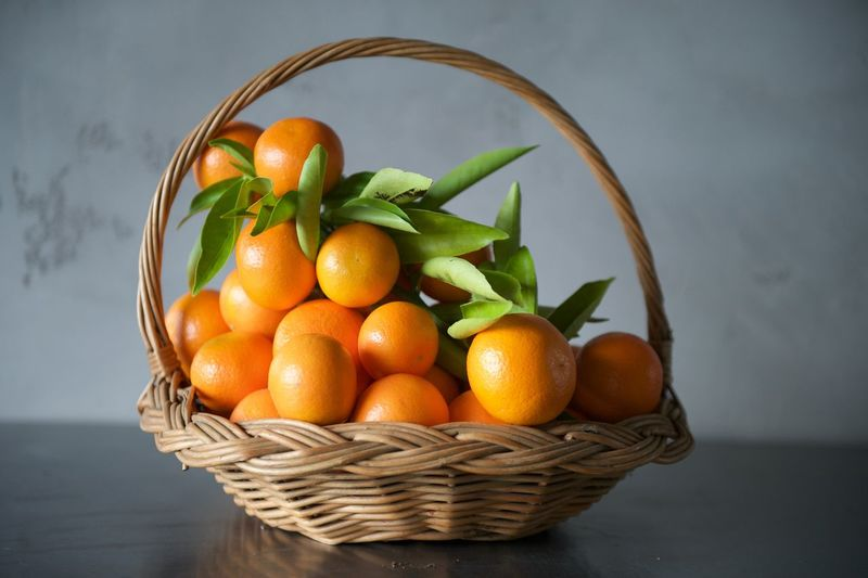 A gathering basket full of ripe tangerines. Abundance Basket Citrus Fruits Close Up Close-up Food Food And Drink Freshness Fruit Full Frame Gathering Basket Healthy Eating Healthy Lifestyle Large Group Of Objects No People Orange Organic Ripe Still Life Tangerines Colour Of Life