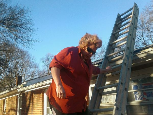 climbing up a ladder to look at my roof ,for storm damage. Woman Climbing Woman Power Woman At Work women around the world Woman Climbing The Ladder Women Who Inspire You One Man Only One Person Adult Only Men Adults Only Mid Adult People Low Angle View Standing Outdoors City Sky Day Clear Sky