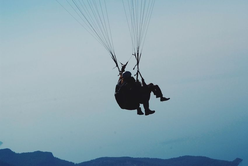 Paragliding free as a bird! Real People Adventure Men Outdoors Lifestyles Leisure Activity Day Extreme Sports Togetherness Nature Parachute Sky People Paragliding Ölüdeniz, Fethiye Turkey