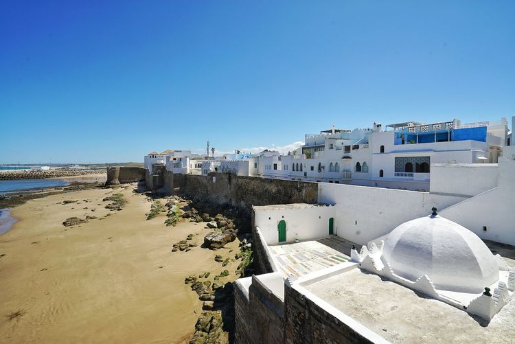 Morocco Photos Sights & Views  Travel Enjoying The View Beach Sea Water Sand Tranquility Clear Sky Nature Outdoors Town Town View Morocco Rural Scene Summer Sky Blue No People Scenics Travel Destinations Day Beauty In Nature Streamzoofamily