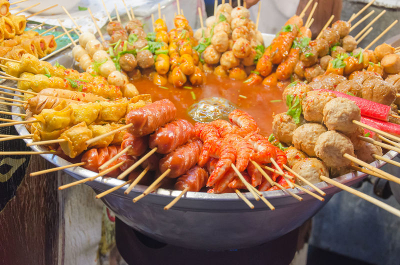 High angle view of skewer food in bowl at table