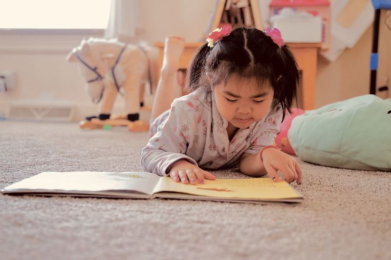 Cute girl reading and lean a book