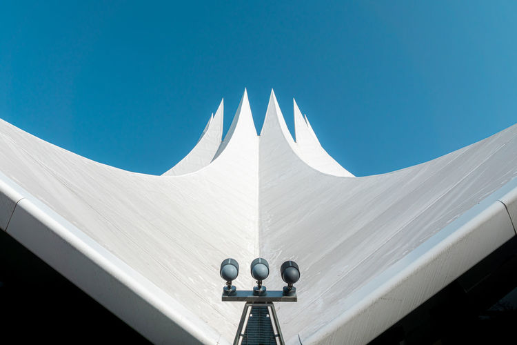 Low angle view of roof against clear blue sky