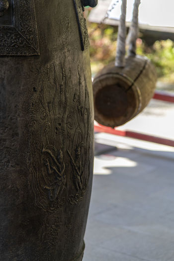 Close-up of chain hanging on pole in city