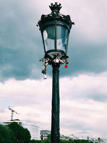 Lock your love away ❤️ Lock Locks Love Paris EyeEm Selects Sky Cloud - Sky Low Angle View Lighting Equipment Street Light Nature Street No People Outdoors Day