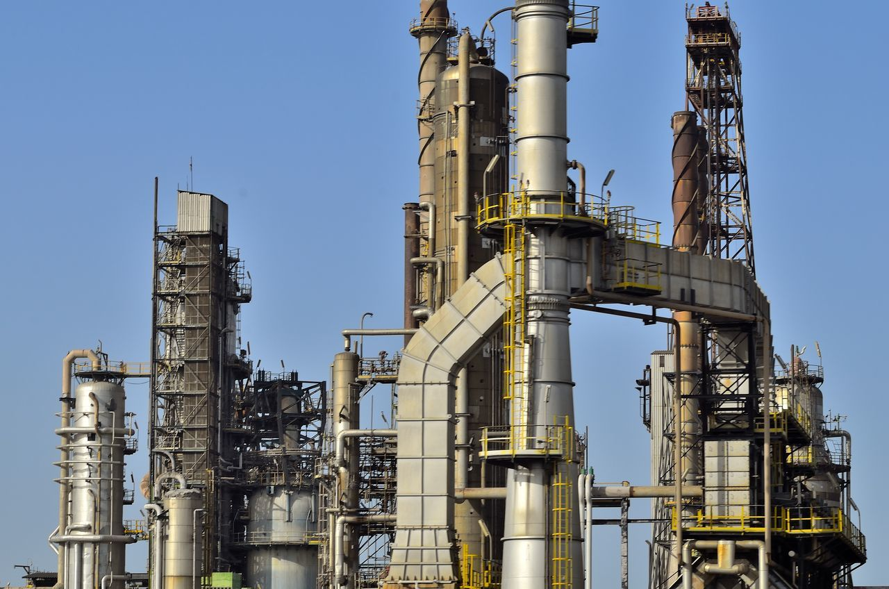 industry, oil industry, factory, oil refinery, refinery, petrochemical plant, fuel and power generation, pipe - tube, smoke stack, pipeline, distillation, storage tank, day, built structure, industrial building, no people, low angle view, clear sky, outdoors, technology