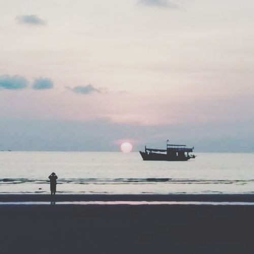 sunset.... Oil Pump Sea Standing Water Full Length Silhouette Beach Men Sky
