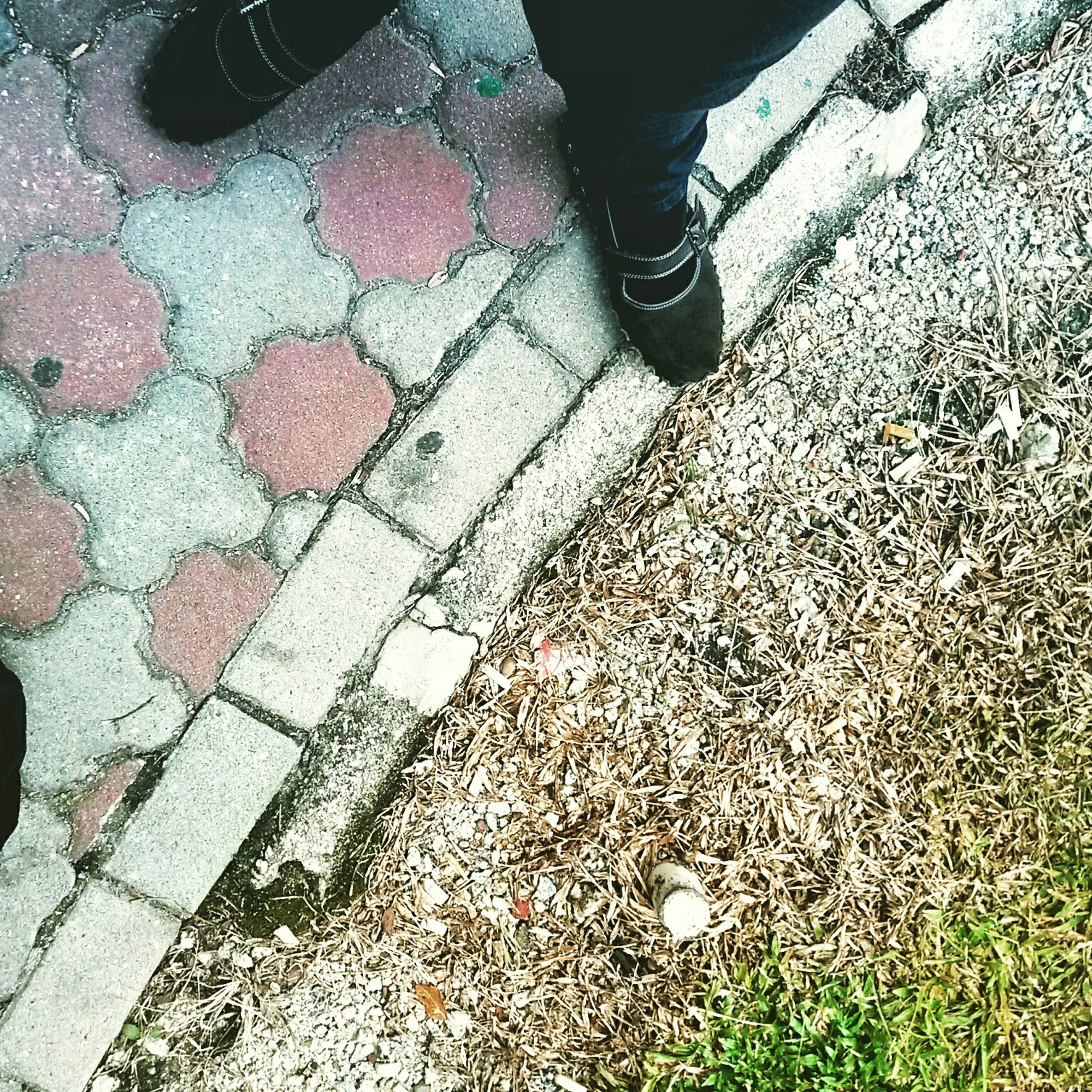 low section, person, standing, shoe, lifestyles, high angle view, street, leisure activity, footpath, cobblestone, human foot, sunlight, footwear, day, outdoors, men, unrecognizable person