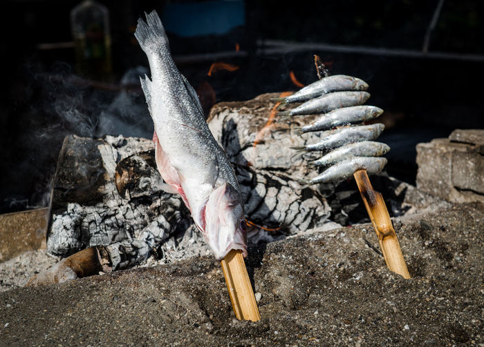 Close-Up Of Fish Roasting On Fire