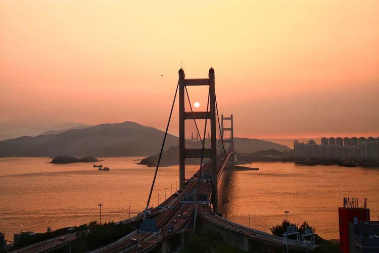 Tsing ma bridge over sea against clear sky during sunset