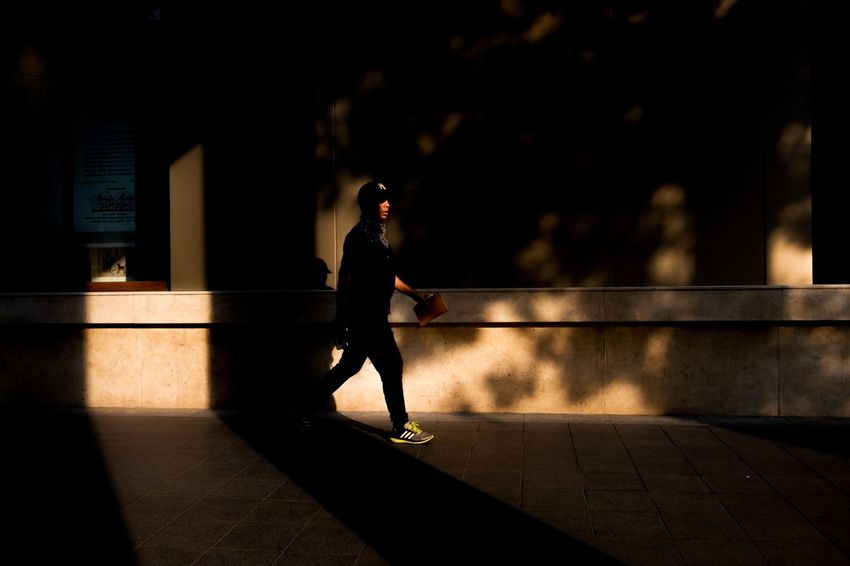 face Candid Public Canpubphoto Candid Streetphotography Streetphoto Street Full Length One Person Jogging Sunlight Lifestyles Silhouette Exercising