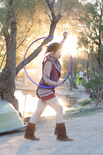 Full Length One Person Motion One Girl Only Summer Women Water Performance Hooping  Joshuatreemusicfestival Flowarts Flowartgirl Girlsports Girl Flowart Outdoors Adult Arts Culture And Entertainment One Young Woman Only Hoop
