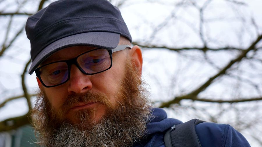 Close-Up Of Bearded Man Wearing Cap And Eyeglasses