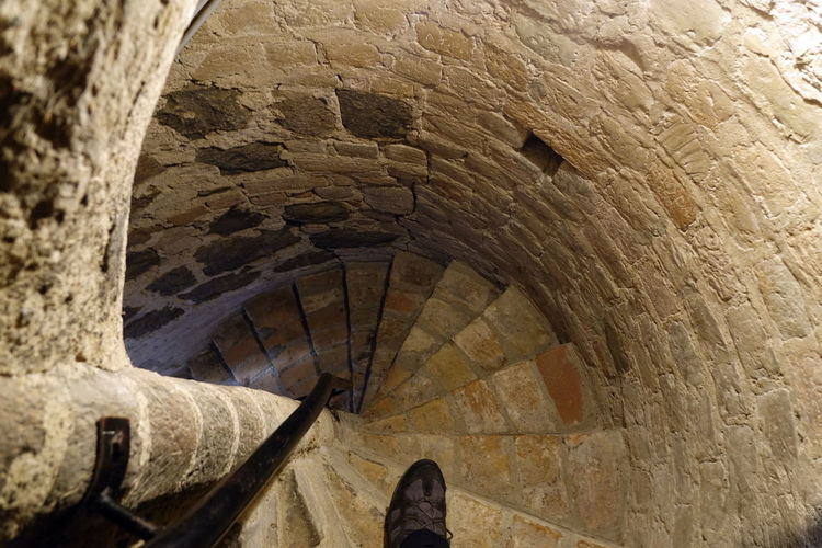 Spiral Staircase Spiral Stairway Ancient Arch Architecture Built Structure Corkscrew Stairs Day Downstairs History Human Body Part Human Leg Indoors  Low Angle View Low Section One Person People Real People Spiral Stair Staircase Steps Steps And Staircases Travel Destinations