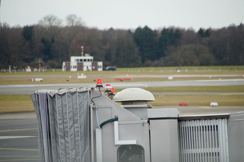 Cropped image of passenger boarding bridge at runway
