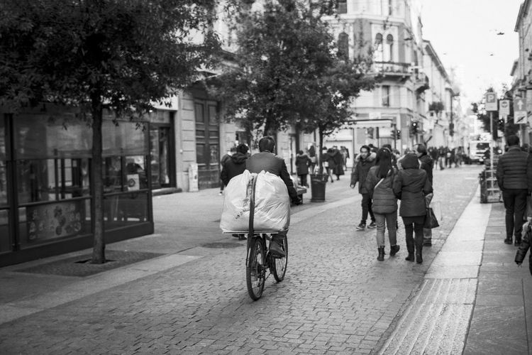 Chinatown, Milan Via Paolo Sarpi, Mila Adult Bicycle Blackandwhite Photography Building Exterior Built Structure City Life Cycling Day Land Vehicle Men Mode Of Transport Outdoors People Rear View Riding Road Street Transportation Walking Mobility In Mega Cities