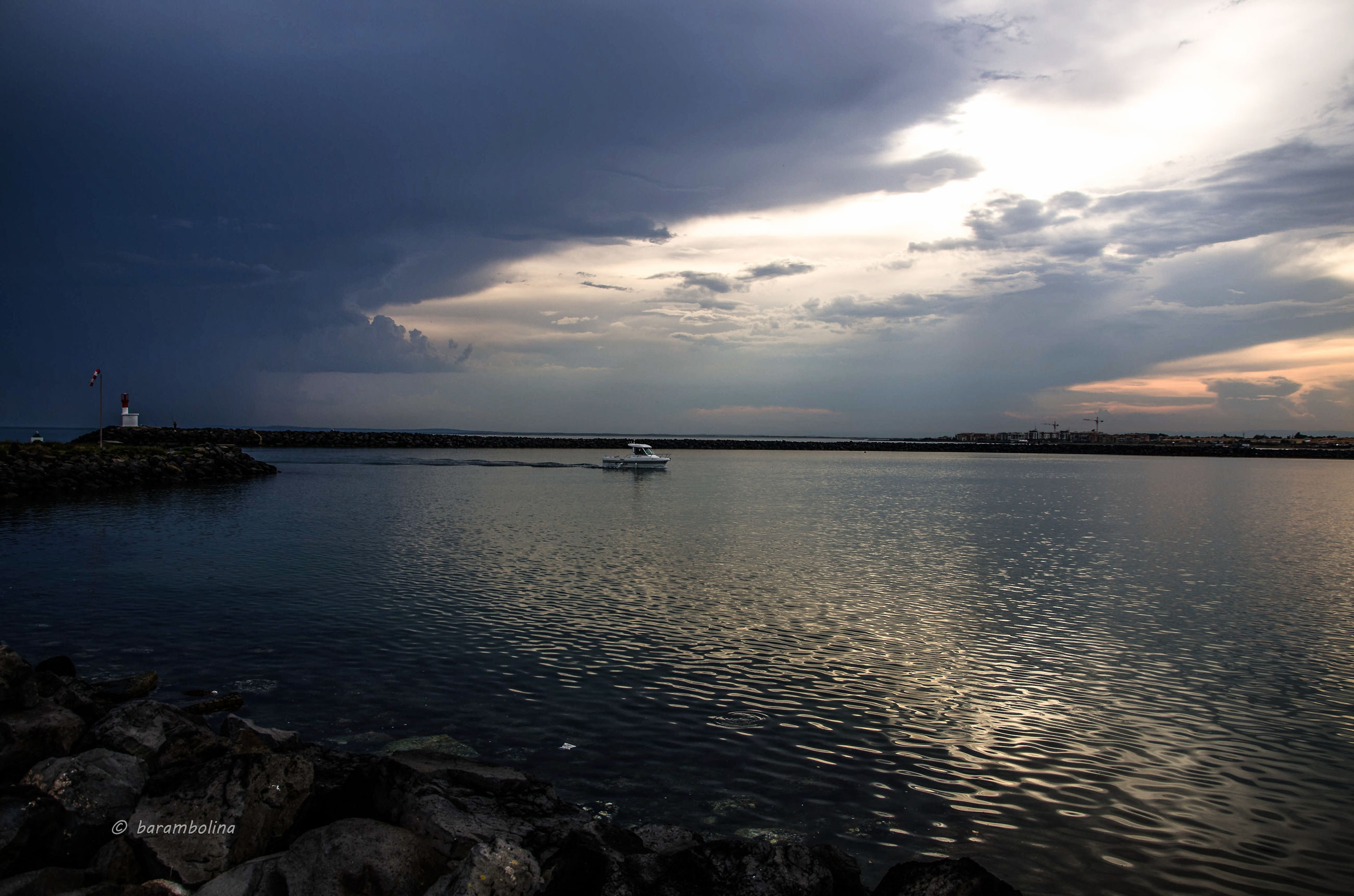 water, sky, sea, cloud - sky, scenics, tranquil scene, tranquility, beauty in nature, cloudy, sunset, nature, horizon over water, waterfront, cloud, idyllic, reflection, rippled, weather, dusk, silhouette