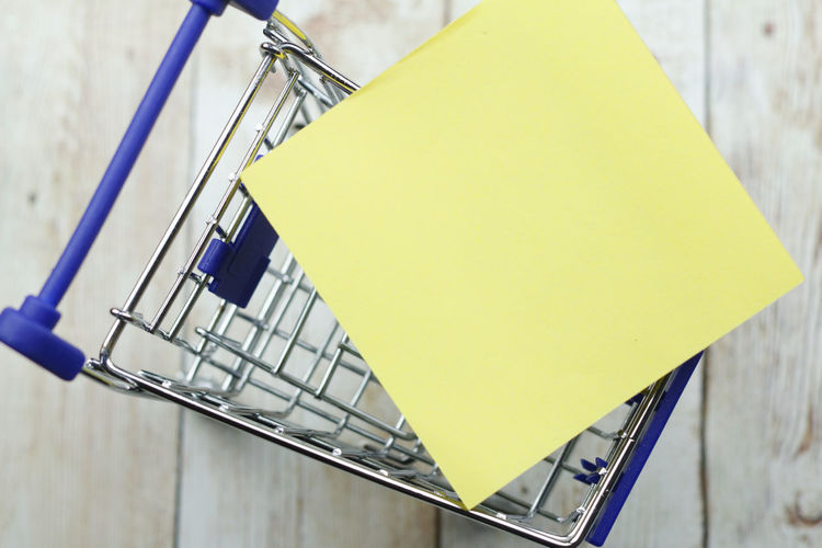 A cart and a blank paper Concept Conceptual Cart Trolley Background Copy Space Copyspace To Do List List Grocery Shopping Financial Shopping ♡ Yellow Adhesive Note Consumerism Close-up Commercial Sign Note - Message