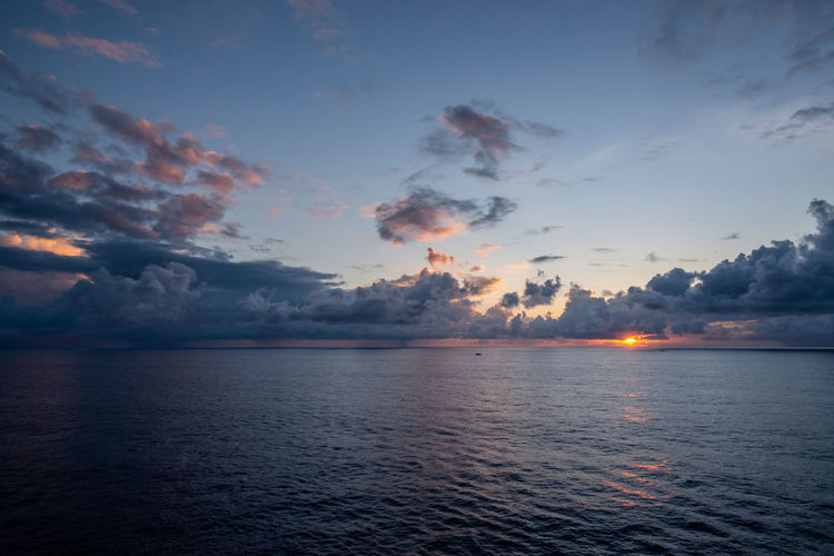 Clouds on horizon Reflection Ripples Beauty In Nature Cloud - Sky Dawn Horizon Nature Ocean Sea Seascape Sky Sunrise Tranquil Scene Tranquility Water