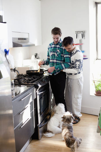 People with dog at home