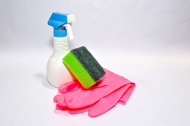 High Angle View Of Cleaning Equipment Over White Background
