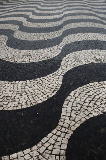 Streets Of Lisbon EyeEm City Lover EyeEm City Shots Lisbon - Portugal Lisboa Portugal Lissabon, Portugal Pattern Backgrounds Full Frame High Angle View No People Footpath Cobblestone Design Day Repetition Textured  Street Sunlight Close-up Outdoors Flooring