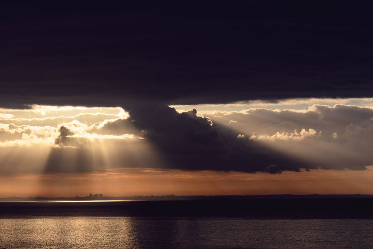 Dramatic sunrise over the Los Angeles skyline with light rays Sky Cloud - Sky Water Beauty In Nature Scenics - Nature Sea Horizon Horizon Over Water Sunset Tranquility Waterfront Nature Idyllic Tranquil Scene Sunlight Sunbeam No People Storm Outdoors Ominous Power In Nature