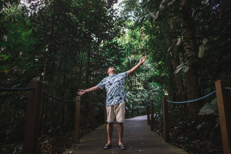Full length of man standing by plants