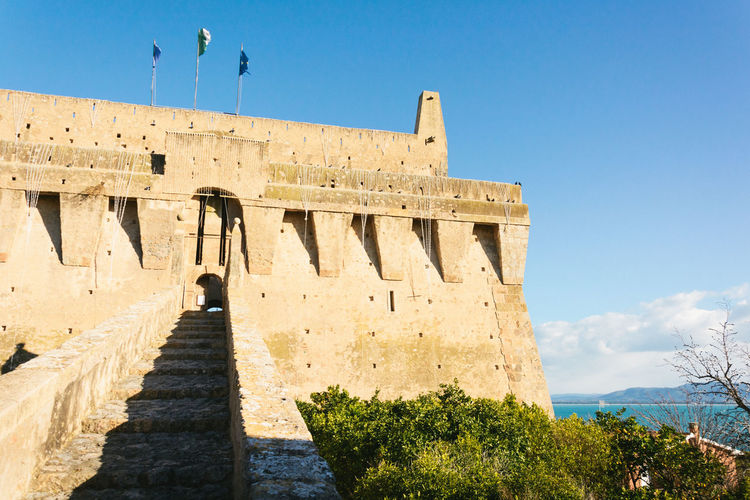 Low Angle View Of Fort Against Sky At Magliano In Toscana